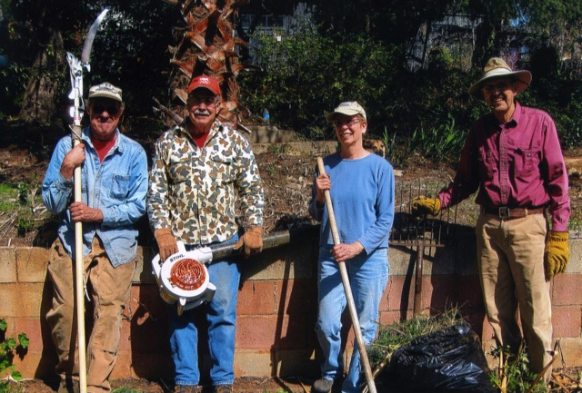 A Brush With Kindness volunteers complete a recent project.